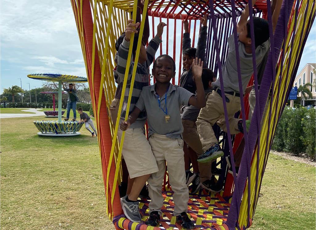 Children playing on Héctor Esrawe and Ignacio Cadena's Los Trompos, Photo: Sarasota Art Museum